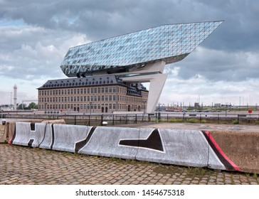 ANTWERP-JUNE 5, 2019. Port House Antwerp at twilight. Zaha Hadid Architects added a glass extension to a renovated fire station. With total of 12,800 square meters headquarters houses a 500 staff.