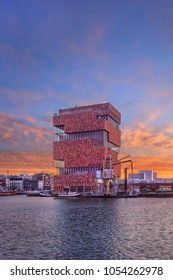 ANTWERP-MARCH 15, 2018. MAS Museum at colored daybreak. Opened in 2011, located in an old harbor on a small island, it exhibits a variety of topics, emphasis on connection between city and world.