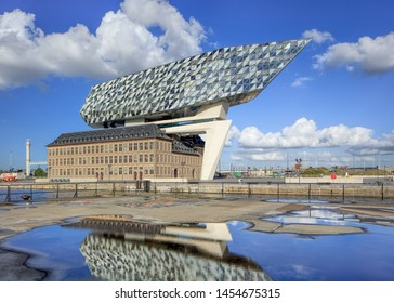 ANTWERP-SEPT. 24 2018. Port House Antwerp on a sunny day. Zaha Hadid Architects added a glass extension to a renovated fire station. With total 12,800 square meters headquarters houses a 500 staff.