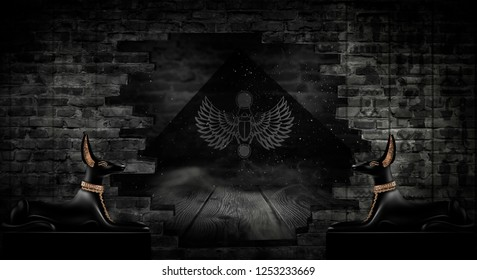 Anubis of Ancient Egypt (God of Death). Dark abstract Egyptian background, dark room with smoke, sparks from lights, rays of light.