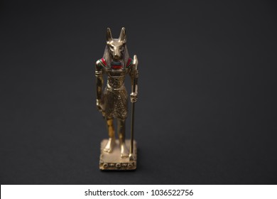 Anubis is the god associated with mummification and the afterlife in ancient Egyptian religion, usually depicted as a canine or a man with a canine/dog head