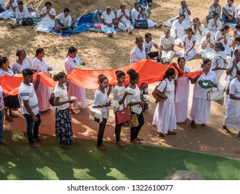 Anuradhapura, Shri lanka - January 27, 2019: Devotees carry a legth of cloth at Mahabodhi temple, Anuradhapura, Shri lanka.