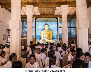 Anuradhapura, Shri Lanka - January 27, 2019: The Buddha image inside Mahabodhi temple of Anuradhapura, Shri Lanka. Devotees are worshipping the Buddha.
