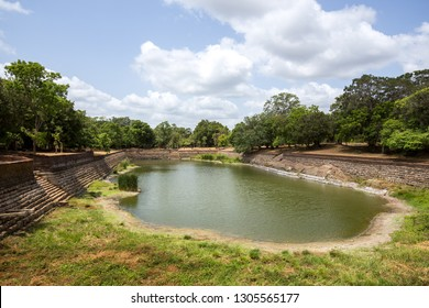Anuradhapura, Sri Lanka - August 21, 2018: The Elephant Pond, Eth Pokuna in the ancient city. It's the largest man-made pond at the UNESCO site of Anuradhapura.
