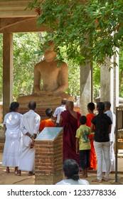 Anuradhapura - Sri  Lanka - Circa 2013 - Pilgrims make prayers and offerings at the sacred Samadhi Buddha.