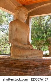Anuradhapura - Sri Lanka - Circa 2013 - the Samadhi Buddha in the grounds of Abhayagiri Monastery ruins.