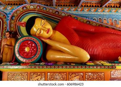 ANURADHAPURA, SRI LANKA - MARCH 3, 2017: The statue of Buddha, reached Nirvana in Isurumuniya Rock Temple, on MARCH 3, 2017 in Anuradhapura, Sri Lanka
