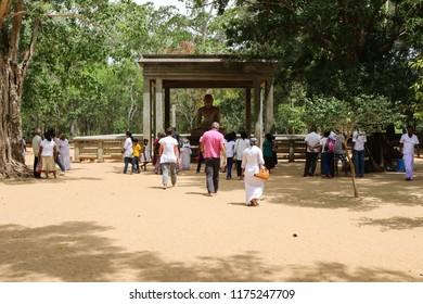 Anuradhapura/Sri Lanka - August 2016: Pilgrims Worshipping for Samadhi Buddha Statue
