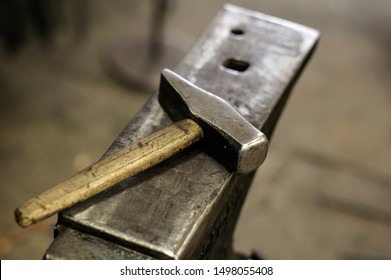 Anvil and hammer, blacksmith tools in the forge