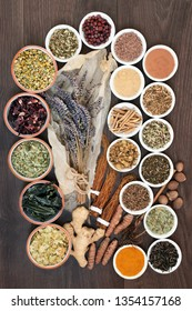 Anxiety and stress relieving herbs and spice selection with supplement powders that also help relaxation and reduce chronic fatigue and depression. Top view on oak wood table.