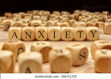 ANXIETY word written on wood block