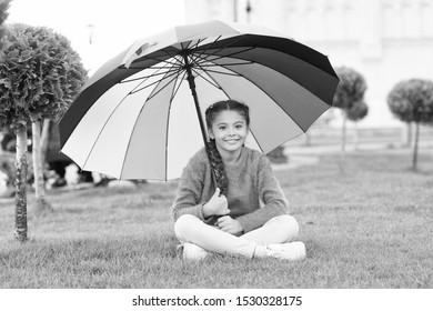 Any weather is good. Rainbow after rain. Multicolored umbrella for little happy girl. Positive mood in autumn weather. cheerful child like weather. Spring weather. Little girl under colorful umbrella.