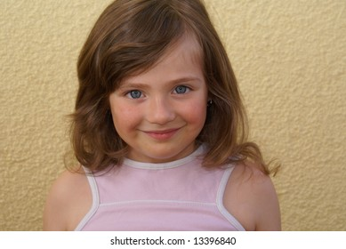 Anyone girls with light hair, the European type. Isolated.    The yellow background.