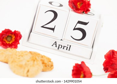 ANZAC Day, April 25, Australian & New Zealand Rememberence holiday with Anzac biscuits and red poppy flowers