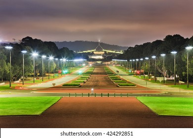 ANZAC parade wide road and street with bright illumination by light poles at sunrise in Canberra, Australia capital city.