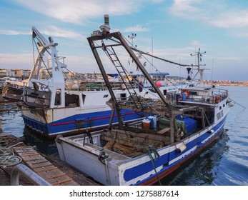 Anzio / Italy - 10 20 2018: Small fishing trawler boats moored at the Anzio marina, well known for its seaside harbour setting, it is a fishing port and a departure point for ferries and hydroplanes.