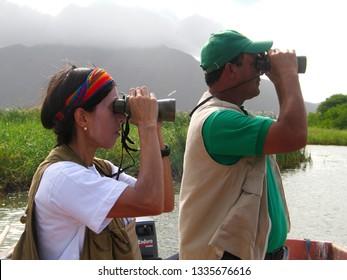 Anzoategui/Venezuela -06 September, 2018: Birders in the outdoors birdwatching during Global Shorebird Counting Program in Unare wetland Venezuela monitoring shorebirds worldwide