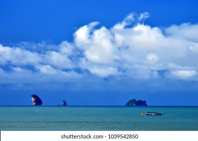 The Ao Nang bay seen from the beach, with limestone islets