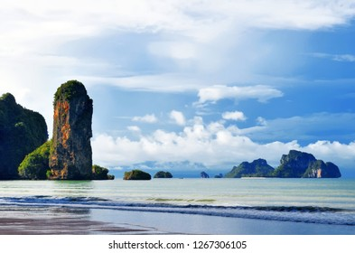 The Ao Nang beach at dawn with its famous boulder and Koh Poda in the background