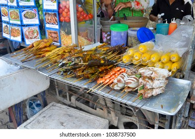 Ao Nang, Krabi province, Thailand - April 23, 2017. Street food stalls on Nopparat Thara Road.