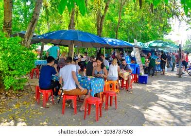Ao Nang, Krabi province, Thailand - April 23, 2017. People seated to eat street food on Nopparat Thara Road.