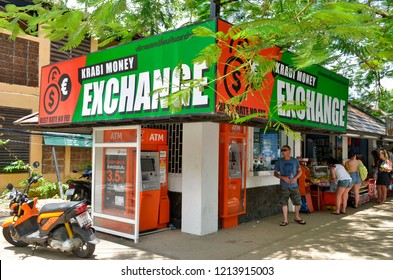 Ao Nang, Krabi province, Thailand - April 23, 2017: Exchange booth with ATMs outside on Nopparat Thara Road (also known as Moo 2).