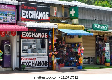 Ao Nang, Krabi province, Thailand - April 23, 2017: An exchange booth among miscellaneous shops on Nopparat Thara Road (also known as Moo 2).