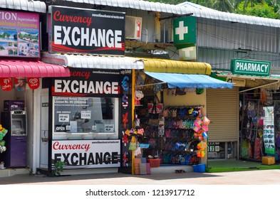 Ao Nang, Krabi province, Thailand - April 23, 2017: An exchange booth among miscellaneous shops on Nopparat Thara Road.