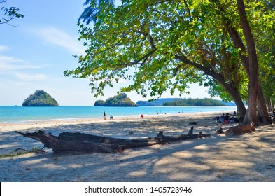 Ao Nang, Thailand - April 10, 2019: Nopparat Thara Beach with Koh Khao Sam Nuai and Koh Liao in the background. This part of the beach is mainly frequented by locals.