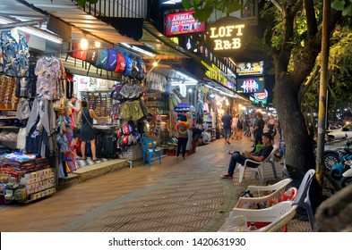 Ao Nang, Thailand - April 10, 2019: The seafront road of the city at night, called Moo 2 or Nopparat Thara Road, full of  restaurants, bars and shops.