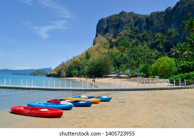 Ao Nang, Thailand - April 11, 2019: Kayaks on Pai Plong Beach, a private secluded beach of Ao Nang entirely occupied by a luxury resort.