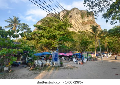 Ao Nang, Thailand - April 11, 2019: Place located at the end of soi Ao Nang 17 along the beach, hosting several massage bungalows at the foot of the limestone cliff.