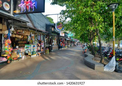 Ao Nang, Thailand - April 11, 2019: The seafront road of the city, called Moo 2 or Nopparat Thara Road, full of  restaurants, bars and shops.
