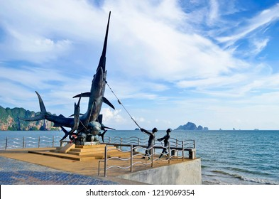 Ao Nang, Thailand - April 21, 2017: Giant swordfish statue along the beach on Nopparat Thara Road with Koh Poda in the background.