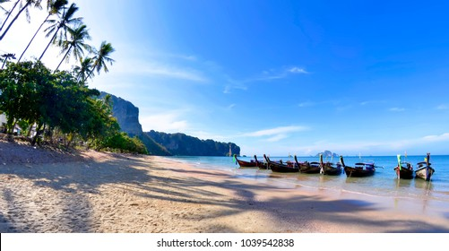 Ao Nang, Thailand - April 29, 2015. Panoramic view of the Ao Nang beach in the morning with long tail boats and Koh Poda visible in the background, in the Andaman Sea.