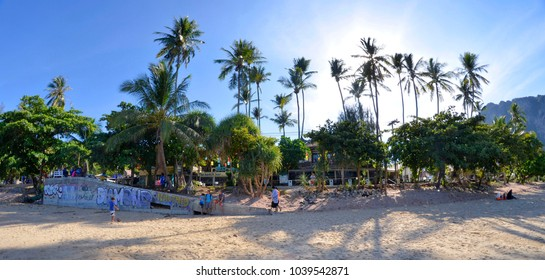 Ao Nang, Thailand - April 29, 2015. Panoramic view of the beach in the morning with a pedestrian walkway full of bars, restaurants, resorts and massage parlors.