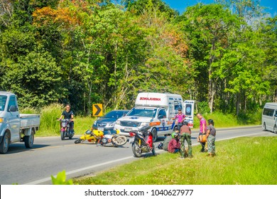 AO NANG, THAILAND - FEBRUARY 09, 2018: Outdoor view of motorcycles accident in the road with an ambulance parked at one side giving the first aids at Ao Nang beach front market