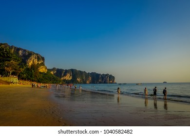 AO NANG, THAILAND - MARCH 05, 2018: Unidentified people at the beach with a mountain in the horizont, Andaman Sea, South of Thailand