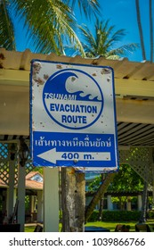 AO NANG, THAILAND - MARCH 19, 2018: Informative sign of evacuation route in case of stunami at Ao Nang beach front market