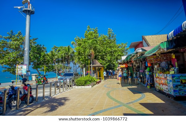 AO NANG, THAILAND - MARCH 19, 2018: Tourist shopping at local shops at Ao Nang beach front market. Ao Nang beach front market is one of famous spot for shopping