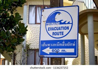 Ao Nang, Thailand - October 21, 2013. Tsunami Evacuation route sign along Ao Nang beach on soi Ao Nang 17.