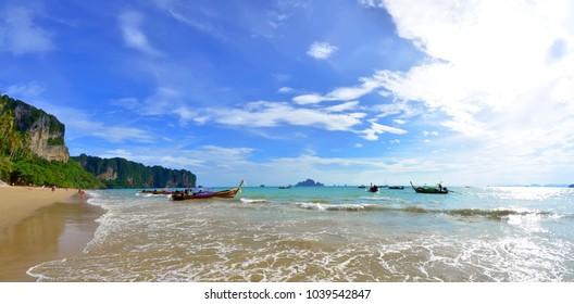 Ao Nang, Thailand - October 23, 2013. Panoramic view of the Ao Nang bay with long tail boats and Koh Poda visible in the background, in the Andaman Sea.