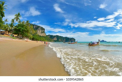 Ao Nang, Thailand - October 23, 2013. The Ao Nang beach with long tail boats and Koh Poda visible in the background, in the Andaman Sea.