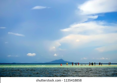 Ao Nang, Thailand - October 24, 2014: Thale Waek, meaning Separated Sea, is the strip of sand that appears only at low tide between Koh Tup and and Koh Kai, in the Andaman Sea, off Ao Nang.