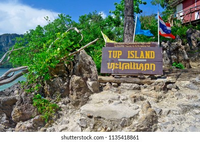 Ao Nang, Thailand - October 24, 2014: The information sign of Koh Tup with the Thai flag.