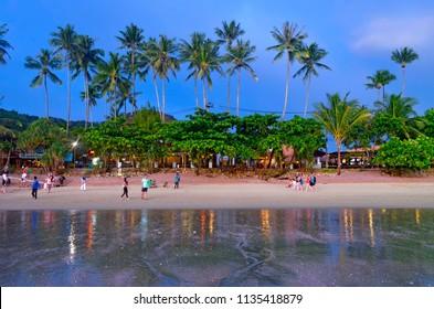 Ao Nang, Thailand - October 24, 2014: Soi Ao Nang 17 at dusk. It's a pedestrian walkway along the Ao Nang beach, with a lot of bars, restaurants, resorts and massage parlors.