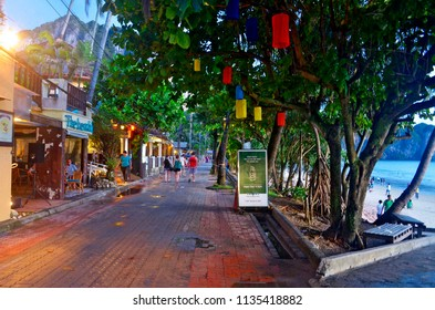 Ao Nang, Thailand - October 24, 2014: Soi Ao Nang 17 at dusk. It's a pedestrian walkway along the Ao Nang beach, with a lot of bars, restaurants, resorts and massage parlors.