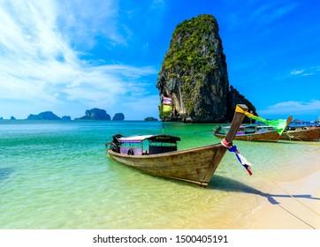 Ao Phra Nang Beach - Thai traditional wooden longtail boat on Railay Peninsula in front of Limestone karst rocks, close to Ao Nang, Krabi province, Andaman Sea, Thailand