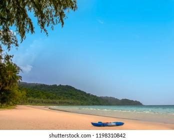 Ao Phrao beach on the tropical island of Ko Kood or Ko Kut in eastern Thailand. A kayak lies on the sandy beach.