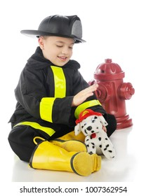 """An aodrable preschool """"fireman"""" petting his dalmation fire puppy. On a white background."""